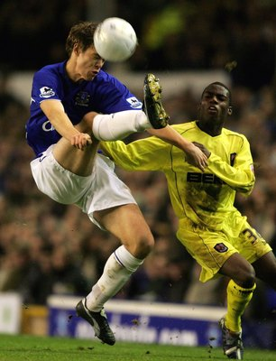 LIVERPOOL, UNITED KINGDOM - JANUARY 18:  Per Kroldrup of Everton is challenged by Marvin Williams of Millwall during the FA Cup Third Round Replay match between Everton and Millwall at Goodison Park on January 18, 2006 in Liverpool, England.  (Photo by Cl