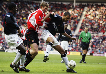 SUNDERLAND - FEBRUARY 1:  Jonathan Fortune of Charlton Athletic holds the ball up against Tore Andre Flo of Sunderland during the FA Barclaycard Premiership match held on February 1, 2003 at the Stadium of Light, in Sunderland, England. Charlton Athletic