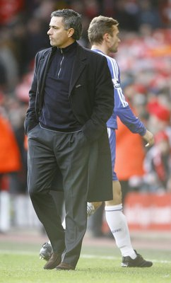 LIVERPOOL, UNITED KINGDOM - JANUARY 20:  Andriy Shevchenko of Chelsea walks off the pitch past Chelsea Manager Jose Mourinho at the end of the Barclays Premiership match between Liverpool and Chelsea at Anfield on January 20, 2007 in Liverpool, England.