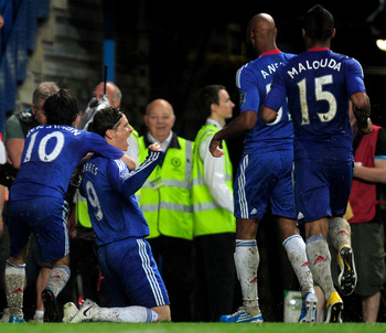 LONDON, ENGLAND - APRIL 23:  Fernando Torres of Chelsea is congratulated by teammates after scoring his team's second goal and the first of his Chelsea career during the Barclays Premier League match between Chelsea and West Ham United at Stamford Bridge