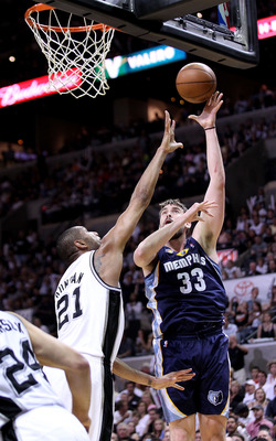 SAN ANTONIO, TX - APRIL 27:  Tim Duncan #21 of the San Antionio Spurs defends against Marc Gasol #33 of the Memphis Grizzlies in Game Five of the Western Conference Quarterfinals in the 2011 NBA Playoffs on April 27, 2011 at AT&T Center in San Antonio, Te