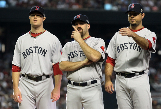 PHOENIX, AZ - JULY 12:  American League All-Star Jon Lester #31 of the Boston Red Sox stands with teammates American League All-Star Kevin Youkilis #20 of the Boston Red Sox and American League All-Star Josh Beckett #19 of the Boston Red Sox before the st