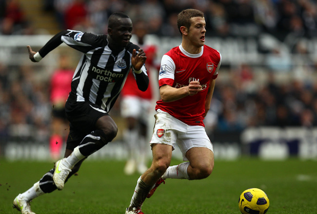NEWCASTLE UPON TYNE, ENGLAND - FEBRUARY 05:  Jack Wilshire of Arsenal battles with Cheik Tiote of Newcastle during the Barclays Premier League match between Newcastle United and Arsenal at St James' Park on February 5, 2011 in Newcastle upon Tyne, England