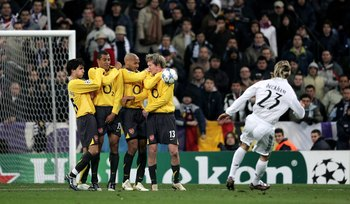 MADRID, SPAIN - FEBRUARY 21:  The Arsenal wall of (L-R) Cesc Fabregas, Gilberto, Thierry Henry and Alexander Hleb deflect Madrid's David Beckham freekick during the UEFA Champions League Round of 16, First Leg match between Real Madrid and Arsenal at the