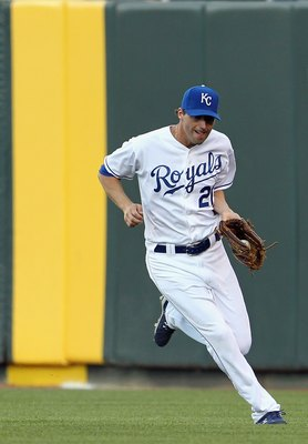 KANSAS CITY, MO - MAY 16:  Jeff Francoeur #21 of the Kansas City Royals makes a catch during the game against the Cleveland Indians on May 16, 2011 at Kauffman Stadium in Kansas City, Missouri.  (Photo by Jamie Squire/Getty Images)