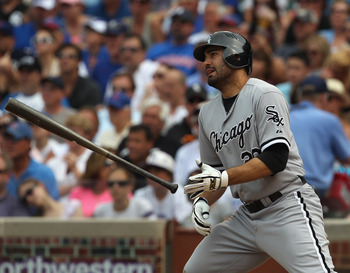 CHICAGO, IL - JULY 01: Carlos Quentin #20 of the Chicago White Sox drops his bat after hitting the ball against the Chicago Cubs at Wrigley Field on July 1, 2011 in Chicago, Illinois. The White Sox defeated the Cubs 6-4. (Photo by Jonathan Daniel/Getty Im