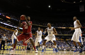 NASHVILLE, TN - MARCH 12:  Jamychal Green #32 of the Alabama Crimson Tide looks to move the ball against John Wall #11 of the Kentucky Wildcats during the quarterfinals of the SEC Men's Basketball Tournament at the Bridgestone Arena on March 12, 2010 in N