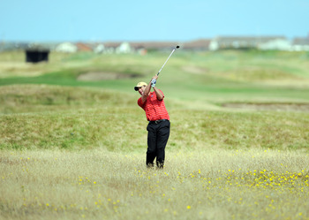 LYTHAM ST ANNES, ENGLAND - JULY 13: Bernard Kitching of Keswick Golf Club plays out of the rough on the eigth hole  during the Virgin Atlantic PGA National Pro-Am Championship - Regional at St Annes Old Links Golf Club on July 13, 2011 in Lytham St Annes,