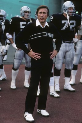 LOS ANGELES - DECEMBER 6:  Head coach Tom Flores and his Los Angeles Raiders wait for team introductions to run onto the field prior to the game against the Buffalo Bills at the Los Angeles Memorial Coliseum on December 6, 1987 in Los Angeles, California.