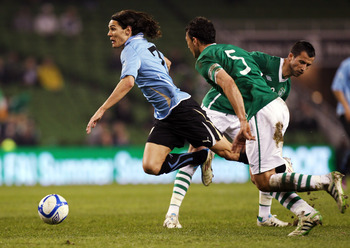 DUBLIN, IRELAND - MARCH 29:  Keith Fahey of Republic of Ireland competes with Edinson Cavani of Uruguay during the International Friendly match between Republic of Ireland and Uruguay at the Aviva Stadium on March 29, 2011 in Dublin, Ireland.  (Photo by I