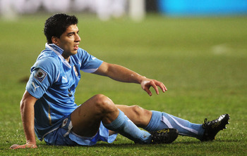 PORT ELIZABETH, SOUTH AFRICA - JULY 10: Luis Suarez of Uruguay picks himself up off the ground during the 2010 FIFA World Cup South Africa Third Place Play-off match between Uruguay and Germany at The Nelson Mandela Bay Stadium on July 10, 2010 in Port El