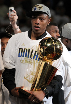 MIAMI, FL - JUNE 12:  Caron Butler of the Dallas Mavericks celebrates with the Larry O'Brien Championship trophy after the Mavericks won 105-95 against the Miami Heat in Game Six of the 2011 NBA Finals at American Airlines Arena on June 12, 2011 in Miami,