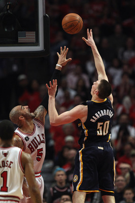 CHICAGO, IL - APRIL 16: Tyler Hansbrough #50 of the Indiana Pacers puts up a shot over Carlos Boozer #5 of the Chicago Bulls in Game One of the Eastern Conference Quarterfinals in the 2011 NBA Playoffs at the United Center on April 16, 2011 in Chicago, Il