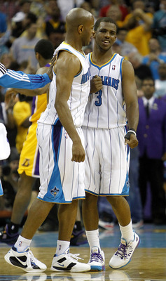 NEW ORLEANS - APRIL 24:  Jarrett Jack #2 of the New Orleans Hornets is greeted by teammate Chris Paul #3 after scoring on the Los Angeles Lakers in Game Four of the Western Conference Quarterfinals in the 2011 NBA Playoffs at New Orleans Arena on April 24