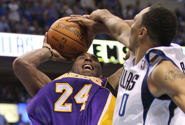 DALLAS, TX - MAY 08:  Guard Kobe Bryant #24 of the Los Angeles Lakers is fouled by Shawn Marion #0 of the Dallas Mavericks in Game Four of the Western Conference Semifinals during the 2011 NBA Playoffs on May 8, 2011 at American Airlines Center in Dallas,