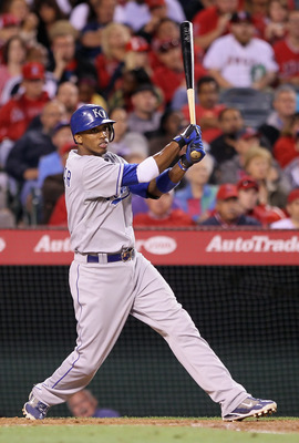 ANAHEIM, CA - JUNE 10:  Alcides Escobar #2 of the Kansas City Royals hits an RBI double against the Los Angeles Angels of Anaheim in the sixth inning at Angel Stadium of Anaheim on June 10, 2011 in Anaheim, California. The Royals defeated the Angels 4-2.