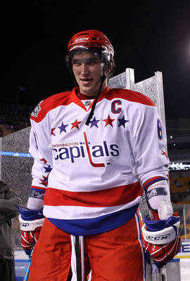 PITTSBURGH, PA - JANUARY 01:  Alex Ovechkin #8 of the Washington Capitals walks off the ice after defeating the Pittsburgh Penguins 3-1 during the 2011 NHL Bridgestone Winter Classic at Heinz Field on January 1, 2011 in Pittsburgh, Pennsylvania.  (Photo b