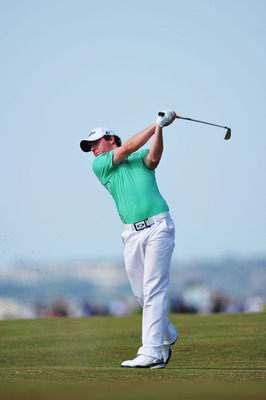 SANDWICH, ENGLAND - JULY 15:  Rory McIlroy of Northern Ireland plays into the 8th green during the second round of The 140th Open Championship at Royal St George's on July 15, 2011 in Sandwich, England.  (Photo by Stuart Franklin/Getty Images)