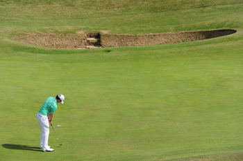 SANDWICH, ENGLAND - JULY 15:  Rory McIlroy of Northern Ireland putts on the 6th green during the second round of The 140th Open Championship at Royal St George's on July 15, 2011 in Sandwich, England.  (Photo by Stuart Franklin/Getty Images)