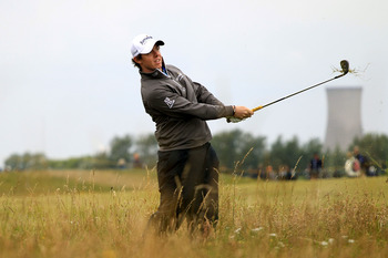 SANDWICH, ENGLAND - JULY 14:  Rory McIlroy of Northern Ireland plays from the rough on the 15th during the first round of The 140th Open Championship at Royal St George's on July 14, 2011 in Sandwich, England.  (Photo by Streeter Lecka/Getty Images)