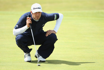 SANDWICH, ENGLAND - JULY 17:  Dustin Johnson of the United States lines up a putt on the 1st green during the final round of The 140th Open Championship at Royal St George's on July 17, 2011 in Sandwich, England.  (Photo by Andrew Redington/Getty Images)