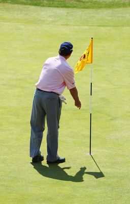 SANDWICH, ENGLAND - JULY 15:  Tom Watson of the United States picks his ball out of the hole, after his hole in one at the sixth hole during the second round of The 140th Open Championship at Royal St George's on July 15, 2011 in Sandwich, England.  (Phot