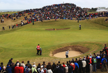 SANDWICH, ENGLAND - JULY 17:  George Coetzee of South Africa plays out of a bunker on the 6th hole during the final round of The 140th Open Championship at Royal St George's on July 17, 2011 in Sandwich, England.  (Photo by Streeter Lecka/Getty Images)