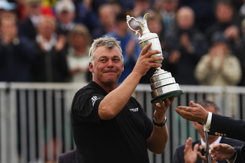 SANDWICH, ENGLAND - JULY 17:  Darren Clarke of Northern Ireland lifts the Claret Jug following his victory at the end of the final round of The 140th Open Championship at Royal St George's on July 17, 2011 in Sandwich, England.  (Photo by Andrew Redington