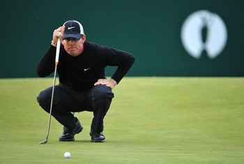 SANDWICH, ENGLAND - JULY 14:  Justin Leonard of the United States lines up his putt on the 18th green during the first round of The 140th Open Championship at Royal St George's on July 14, 2011 in Sandwich, England. (Photo by Stuart Franklin/Getty Images)
