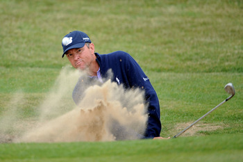 SANDWICH, ENGLAND - JULY 14:   Davis Love III of the United States hits from a bunker on the 6th hole during the first round of The 140th Open Championship at Royal St George's on July 14, 2011 in Sandwich, England. (Photo by Stuart Franklin/Getty Images)