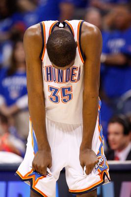OKLAHOMA CITY, OK - MAY 23:  Kevin Durant #35 of the Oklahoma City Thunder reacts after the Dallas Mavericks defeat the Thunder 112-105 in overtime in Game Four of the Western Conference Finals during the 2011 NBA Playoffs at Oklahoma City Arena on May 23