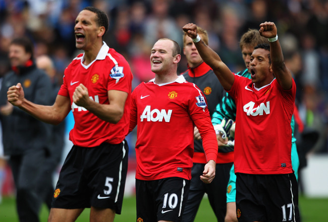BLACKBURN, ENGLAND - MAY 14: (L-R)  Rio Ferdinand, Wayne Rooney and Nani of Manchester United celebrate after drawing the Barclays Premier League match between Blackburn Rovers and Manchester United but winning the title at Ewood park on May 14, 2011 in B
