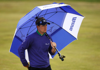 SANDWICH, ENGLAND - JULY 14:  Luke Donald of England walks with his umbrella during the first round of The 140th Open Championship at Royal St George's on July 14, 2011 in Sandwich, England.  (Photo by Andrew Redington/Getty Images)