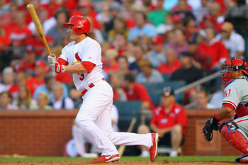 ST. LOUIS, MO - JUNE 23: Ryan Theriot #3 of the St. Louis Cardinals hits a two-RBI single against the Philadelphia Phillies at Busch Stadium on June 23, 2011 in St. Louis, Missouri.  (Photo by Dilip Vishwanat/Getty Images)