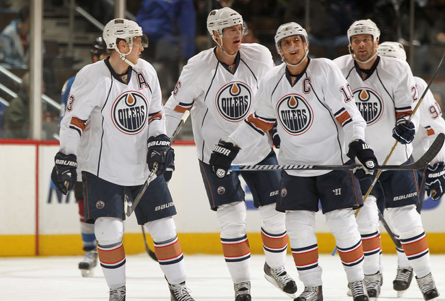 DENVER, CO - FEBRUARY 23:  (L-R) Ales Hemsky #83, Kurtis Foster #26, Shawn Horcoff #10, Dustin Penner #27  and Magnus Paajarvi #91 of the Edmonton Oilers skate toward the bench as they celebrate a goal against the Colorado Avalanche at the Pepsi Center on