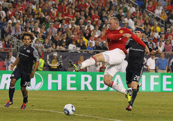 FOXBORO, MA - JULY 13: Wayne Rooney #10 of the Manchester United shoots on net against the New England Revolution during a friendly match at Gillette Stadium on July 13, 2011 in Foxboro, Massachusetts. (Photo by Jim Rogash/Getty Images)