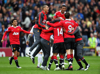 BLACKBURN, ENGLAND - MAY 14:  (L-R)  Rio Ferdinand, Wayne Rooney and Nani of Manchester United celebrate after drawing the Barclays Premier League match between Blackburn Rovers and Manchester United but winning the title at Ewood park on May 14, 2011 in