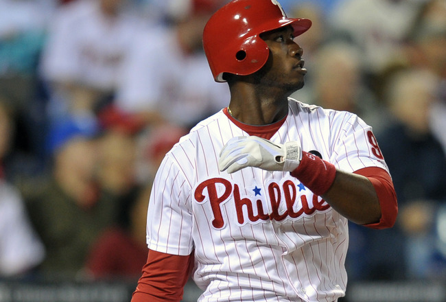 PHILADELPHIA, PA - JUNE 14: Domonic Brown #9 of the Philadelphia Phillies watches the ball on a fly out during the game against the Florida Marlins at Citizens Bank Park on June 14, 2011 in Philadelphia, Pennsylvania. The Phillies won 9-1. (Photo by Drew