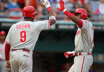 MIAMI GARDENS, FL - JULY 06:  John Mayberry, Jr. #15 of the Philadelphia Phillies celebrates a two-run home run with teammate Dominic Brown #9 against the Florida Marlins at Sun Life Stadium on July 6, 2011 in Miami Gardens, Florida.  (Photo by Marc Serot