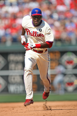 PHILADELPHIA - JULY 10: Left fielder John Mayberry Jr. #15 of the Philadelphia Phillies runs to third base during a game against the Atlanta Braves at Citizens Bank Park on July 10, 2011 in Philadelphia, Pennsylvania. The Phillies won 14-1. (Photo by Hunt