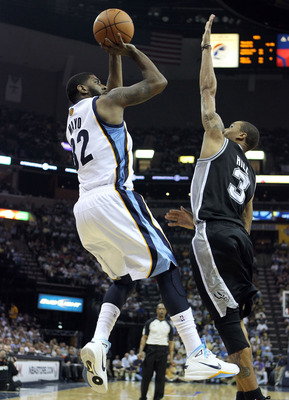 MEMPHIS, TN - APRIL 23:  O.J. Mayo #32 of the  Memphis Grizzlies shoots the ball while defended by George Hill #3 of the San Antonio Spurs in Game three of the Western Conference Quarterfinals in the 2011 NBA Playoffs at FedExForum on April 23, 2011 in Me