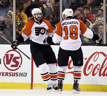 BOSTON - MAY 14:  Simon Gagne #12 of the Philadelphia Flyers is congratulated by teammate Mike Richards #18 after Gagne scored the game winner on a power play in the third period against the Boston Bruins in Game Seven of the Eastern Conference Semifinals