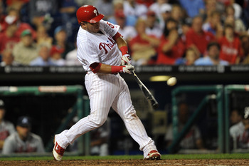PHILADELPHIA, PA - JULY 08: Carlos Ruiz #51 of the Philadelphia Phillies hits a one run home-run in the bottom of the fourth inning during the game against the Atlanta Braves at Citizens Bank Park on July 8, 2011 in Philadelphia, Pennsylvania. (Photo by D