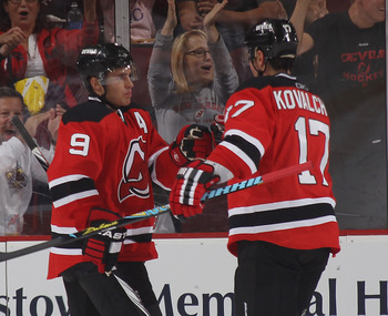 NEWARK, NJ - OCTOBER 01: Zach Parise #9 and Ilya Kovalchuk #17 of the New Jersey Devils celebrate Parise's goal at 14:14 of the first period against the New York Islanders at the Prudential Center on October 1, 2010 in Newark, New Jersey.  (Photo by Bruce