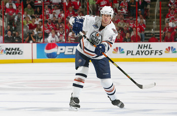 RALEIGH, NC - JUNE 19:  Chris Pronger #44 of the Edmonton Oilers follows through on a pass against the Carolina Hurricanes during game seven of the 2006 NHL Stanley Cup Finals on June 19, 2006 at the RBC Center in Raleigh, North Carolina. The Hurricanes d