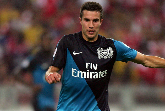 KUALA LUMPUR, MALAYSIA - JULY 13: Robin Van Persie of Arsenal in action during the pre-season Asian Tour friendly match between Malaysia and Arsenal at Bukit Jalil National Stadium on July 13, 2011 in Kuala Lumpur, Malaysia.  (Photo by Stanley Chou/Getty
