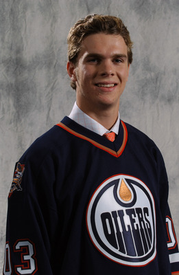 NASHVILLE, TN - JUNE 21:  Marc-Antoine Pouliot the first round draft pick (#22 overall) of the Edmonton Oilers poses for a portrait after the 2003 NHL Entry Draft at the Gaylord Entertainment Center on June 21, 2003 in Nashville, Tennessee. (Photo by Dave