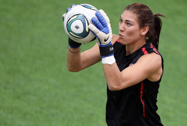 FRANKFURT AM MAIN, GERMANY - JULY 16:  Hope Solo of USA saves a ball during the USA team training session at FIFA World Cup Stadium Frankfurt on July 16, 2011 in Frankfurt am Main, Germany.  (Photo by Christof Koepsel/Getty Images)
