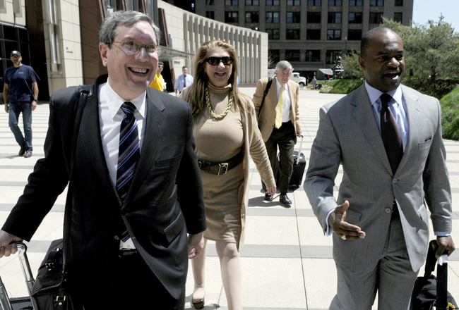 MINNEAPOLIS, MN - MAY 17: NFL players' lawyers Jeffrey Kessler (L), Barbara P. Berens and James Quinn walk with former NFL Players Association executive director DeMaurice Smith after leaving court ordered mediation at the U.S. Courthouse on May 17, 2011
