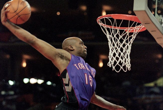 13 Feb 2000: Vince Carter #15 of the Toronto Raptors jumps to dunk the ball during the NBA All - Star Weekend Slam Dunk Contest at the Oakland Coliseum in Oakland, California.